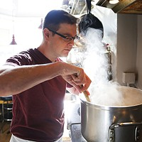 Paul Kawlec, Cowner and chef of Café Du Jour, prepares chickpea soup.