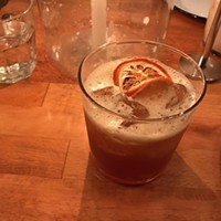 Fernet, scotch, and apple cider cocktail at Apteka