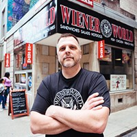 Dennis Scott, owner of Wiener World, in front of his new sign