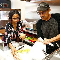 Randy and Becky Thompson prepare a to-go meal at their restaurant.