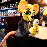 Pittsburgh furry Rhythm poses inside Klavon's Ice Cream Parlor.