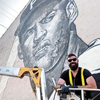 Jeremy Raymer painting his Roberto Clemente mural