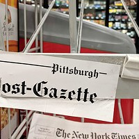 An empty <i>Pittsburgh Post-Gazette </i>rack in Downtown
