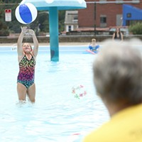 Olivia Orlando, 8, hits a beach ball back to her grandmother, Denise Finley, at the Bloomfield pool