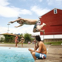 Rich Thewes jumps over his friend, Dustin Klein, before diving into the Bloomfield pool