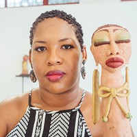 Dominique Scaife with her artwork