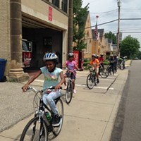 School kids learn to ride through the city streets thanks to Bike PGH's Positive Spin