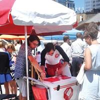 The Pop Stop cart sells a variety of frozen treats on sticks