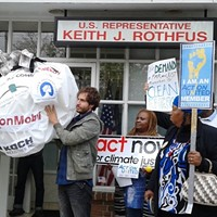 "Pittsburgh Climate Movement protesters carry ""dirty money"" to Congressman Keith Rothfus' office"