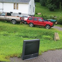 A TV awaits trash pickup that won't come.