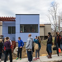 Residents line up to view the completed tiny house in Pittsburgh's Garfield neighborhood