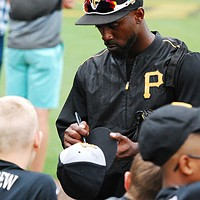 Andrew McCutchen signs autographs for kids at Pirates spring training in Bradenton, Florida