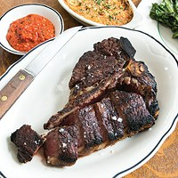 Porterhouse steak with Romesco sauce, carrots au gratin and grilled escarole