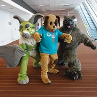Western PA Humane Society's mascot Barkley the dog with furries at Anthrocon 2015.