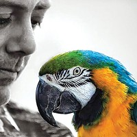 Kenny Sprouse with one of his parrots