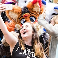 Furries show off their finest 'fursuits' to the public in Anthrocon's annual Fursuit Parade