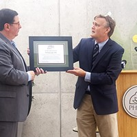 Tim Beatley (right) presents Mayor Bill Peduto with a Biophilic City certificate