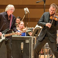 With a new concerto, former R.E.M. bassist bridges the gap between rock and classical