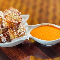 House-made tater tots, parmesan-bacon powder and <i>piquillo</i> aioli