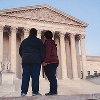 A gay couple outside the Supreme Court