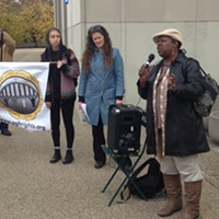Mischelle McMillan speaks to the crowd at an affordable-housing rally in Oakland.