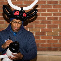 Derrick from Steel City Balloons wears a Krampus hat made from balloons