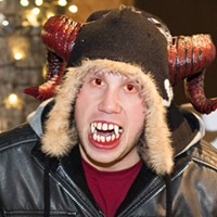 Kris Grady wears red contacts for his Krampus costume.