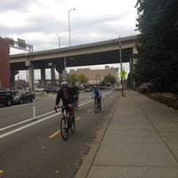 Bike riders on Penn Avenue protected bike lane