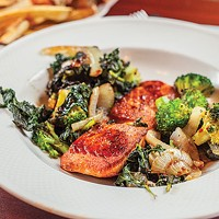 Seared salmon with an Asian-style glaze, sautéed greens and broccoli