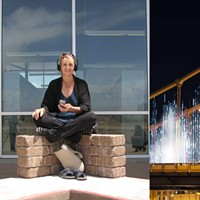 "Andrea Polli (center) and her ""Energy Flow"" on the Rachel Carson Bridge"