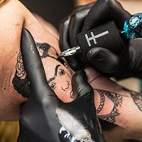 Marcus Nati from Stay Gold Tattoo gives Angela Skinner a Frida Kahlo civil-rights tattoo.