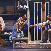 From left: Tom Driscoll, Delana Flowers and Monteze Freeland in Hiawatha Project's <i>JH: Mechanics of a Legend</i>