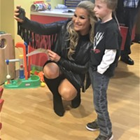 WWE's Natalya Neidhart takes a selfie with a young fan at Pittsburgh Children's Hospital Tuesday