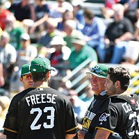 Pittsburgh Pirates manager Clint Hurdle chats with his infield during a pitching change March 17