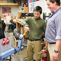 Meredith Grelli, John Choi and Chris Moehle test the malting robot.