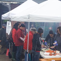 Revelers take a break from the music to grab some food.