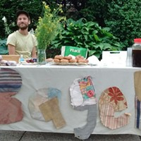 Justin Lubecki at the Friendship Bagel stand