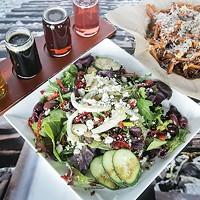 Mediterranean salad, garlic-parmesan fries and a beer flight