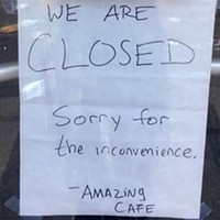 Sign posted on South Side's Amazing Cafe