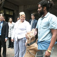 Pit bull King with his owners during a press conference at the Allegheny County Courthouse on Wed., June 7.