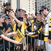 Evgeni Malkin poses with fans during the Penguins' 2017 Stanley Cup parade.