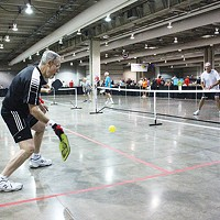 A player returns a serve during a recent pickleball tournament Downtown.