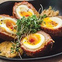 Scotch eggs: sambal mustard, seven-minute egg, housemade sausage and English toast crust
