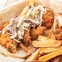 Oyster po' boy with fries and cole slaw