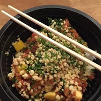 Poke bowl with spicy tuna, white rice, mango, kale, cucumber, nori and tempura flakes, spicy mayo and house poke sauce