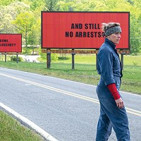 Mildred (Frances McDormand) by her billboards