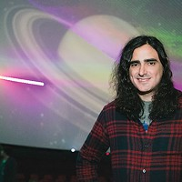 Andre Costello in the planetarium at Carnegie Science Center