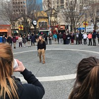 Dozens of high school students gather in Market Square in Downtown after walking out of class