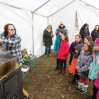 Judy Ruskowski, volunteer naturalist, demonstrating to scouts