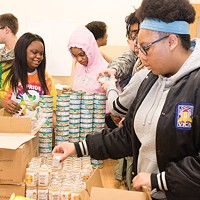 Students from Perry High School help organize the food pantry